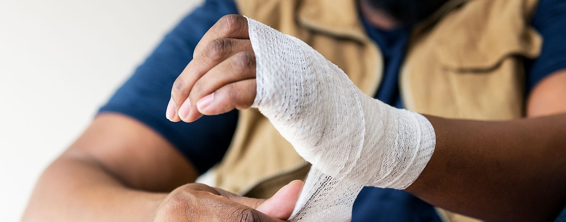 A person wearing a cast on their hand